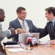 Three businessmen in a meeting celebrating a success — Stock Photo