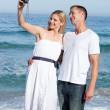 Stock Photo: Enamored couple taking photography