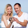 Enamored couple looking at holiday photograph — Stock Photo #10292202