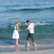 Loving couple having fun at the shore line — Stock Photo #10292205
