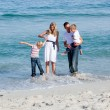 Foto Stock: Lively family having fun at the beach