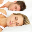 Portrait of a young couple sleeping on their bed — Stock Photo