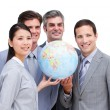 Confident businessteam looking at terrestrial globe — Stock Photo #10292358