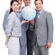 Successful businessteam looking at terrestrial globe — Stock Photo #10292370