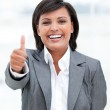 Portrait of a fortunate business woman with a thumb up — Stock Photo