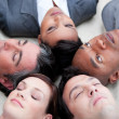 Close-up of relaxed business team lying in circle — Stock Photo
