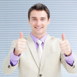 Successful businessman with thumbs up — Stock Photo #10292564