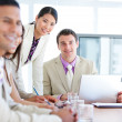 Multi-ethnic business team in a meeting - Stock Photo