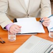 Close-up of a businessman working in a meeting - Stock Photo