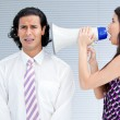 Angry businesswoman yelling through a megaphone — Stock Photo #10292608