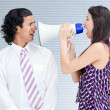 Furious businesswoman yelling through a megaphone — Stock Photo