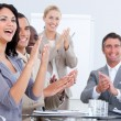 Cheerful business applauding in a meeting — Foto Stock