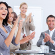 Cheerful business applauding in a meeting — Stock Photo
