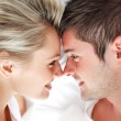 Close-up of smiling couple looking at each other — Stock Photo