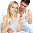 Couple eating strawberries and drinking champagne — Stock Photo