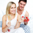 Loves eating strawberries and drinking champagne — Stock Photo