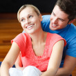Lovers sitting in their new house — Stock Photo