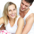 Man and woman sitting on bed — Stock Photo