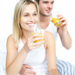 Lovers drinking orange juice in bed — Stock Photo #10292792