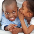 Adorable little girl whispering something to her brother — Stock Photo #10292861