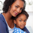 Portrait of a beautiful mother and her daughter — Stock Photo