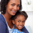 Stock Photo: Smiling mother and her little girl