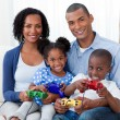 Smiling Afro-american family playing video games — Stock Photo