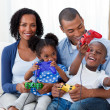 Happy Afro-american family playing video games — Stock Photo #10292996