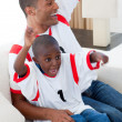 Happy father and his son celebrating a goal — Stock Photo #10293007