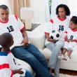Afro-american family watching a football match — Stock Photo #10293011