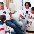 Afro-americfamily watching football match — Stock Photo #10293011