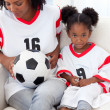 Stock Photo: Mother and her daughter watching a football match