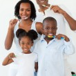 Smiling family brushing their teeth — Stock Photo #10293042