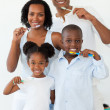 Stock Photo: Smiling family brushing their teeth