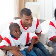 Happy family watching football match — Stock Photo #10293043