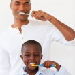 Father and his son brushing their teeth — Stock Photo #10293047