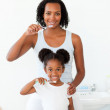 Mother and her daughter brushing their teeth — Stock Photo #10293051