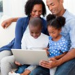 Happy family using laptop — Stock Photo #10293057