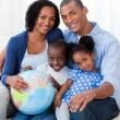 Afro-americfamily holding terrestrial globe — Stock Photo #10293060