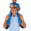Happy father giving son piggyback ride — Stock Photo