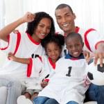 Afro-American family celebrating a football goal — Stock Photo