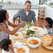 Stockfoto: Jolly family dining together