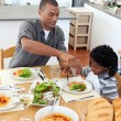 Ethnic little boy dining with his father — Stockfoto