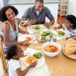 Smiling family dining together — Stockfoto #10293127