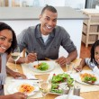 Stockfoto: Ethnic couple dining with their son