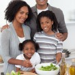 Afro-american family preparing salad together — Stock Photo