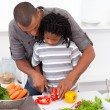 Loving father helping his son cut vegetables — Stock Photo #10293181