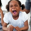 Angry little girl shouting - Stock Photo