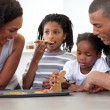 Happy afro-american family eating homemade biscuits — Stock Photo