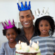 Smiling father with his children celebrating a birthday — Stock Photo